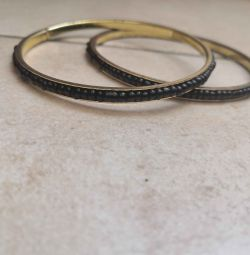 2 black bracelets