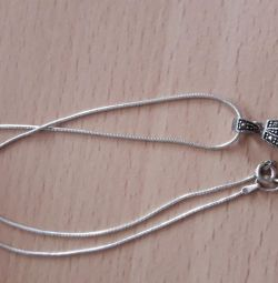 Silver pendant on a chain