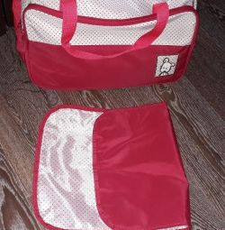 Bag for baby clothes and baby rug