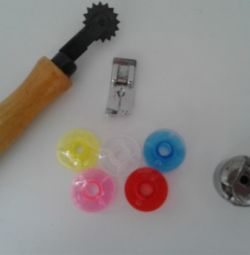 Colored plastic bobbins for sewing machines