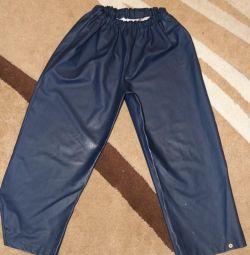 Прорезиненные штаны на 128 см.