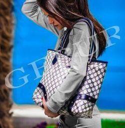 Eco-leather handbag and raincoat