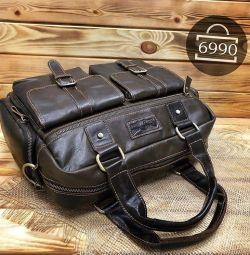 Вместительная мужская сумка из натуральной кожи