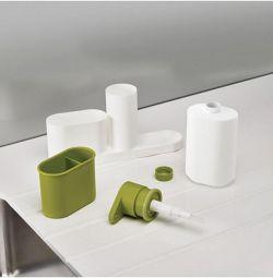 Sink organizer for soap dispenser