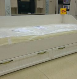 Bed with orthopedic mattress