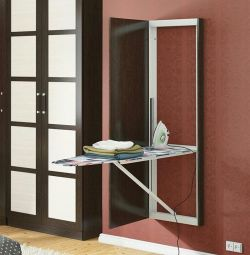 Panel with a mirror with built-in ironing board