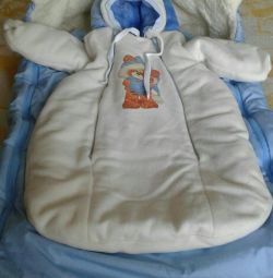 envelope and jumpsuit for a newborn