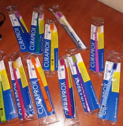 Toothbrushes and toothpastes CURAPROX.
