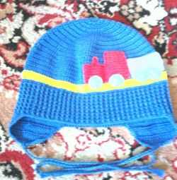 Selling a baby hat.