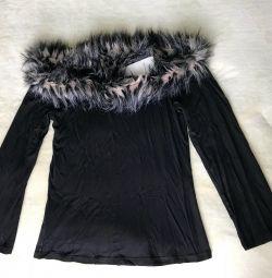 O nouă jachetă cu blană, cu o etichetă