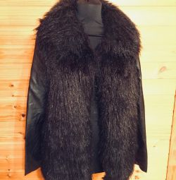 Faux fur coat with leather sleeves