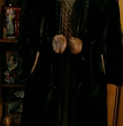 Muton fur coat with a hood