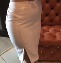 A stunned beige skirt with a slit