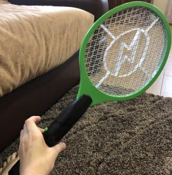 Battery operated racket for killing flies