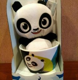 Cup with a toy Panda