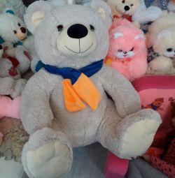 Teddy bear in a stylish scarf