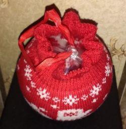 Recipient cu bilă într-un sac de Anul Nou