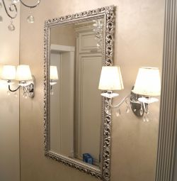 Mirror wall in a silver frame.