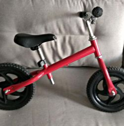 Red children's runbike