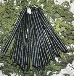 Black candle with nettle