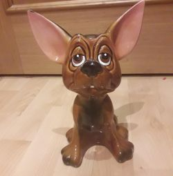 The ceramic figure of the dog.