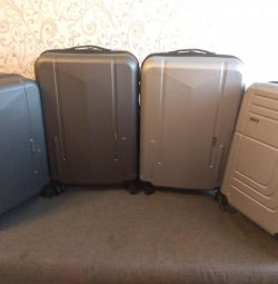 New durable suitcase on wheels, 58 and 98 liters