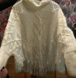 New.?Poncho with a sleeve. Wonderful gift