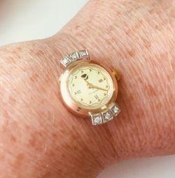 Gold mechanical watch with diamonds
