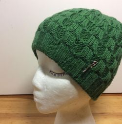 Luxurious knitted hat of green color, art 264