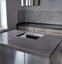 Kitchen worktop with artificial stone island