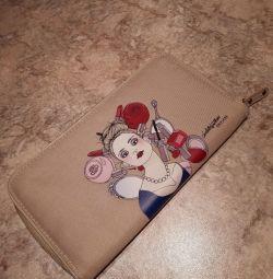 Convenient textile purse for rail and air tickets.