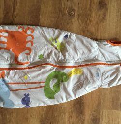 Put on a baby sleeping bag