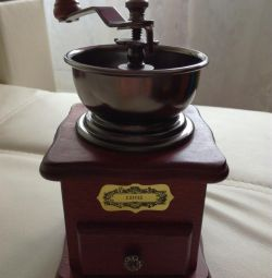 Manual coffee grinder. Coffee beans as a gift