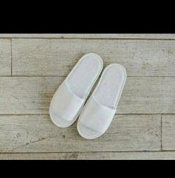 Λευκά παντόφλες για ξενοδοχεία
