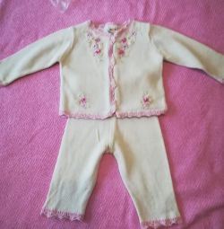 The suit is knitted from 9 months to 1.5