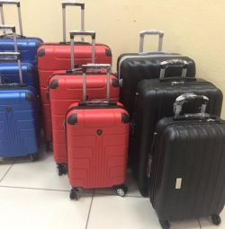 Suitcases. New. Different colors