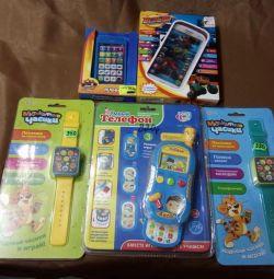Детские музыкальные часы,телефоны