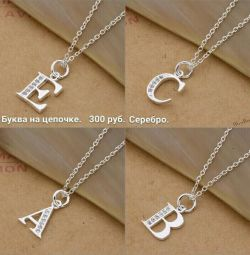 Pendant with chain. Silver plated. There are different letters.