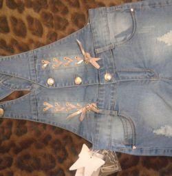 нові джинсові шорти на лямках