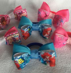 Bows for the first ponytails with cartoon characters