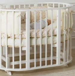 Round convertible cot