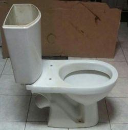 Toaletă cu rezervor