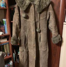 Sheepskin coat female with a hood