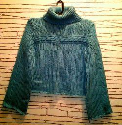 Μεγάλη ποικιλία γυναικείων πουλόβερ από μαλλί.