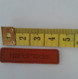 Tags for clothing made of leatherette and wood