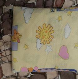 Подушка в кроватку с наволочкой