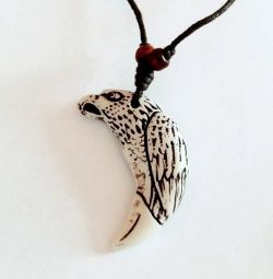Pendant-amulet in the form of an eagle and canine