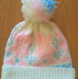 The hat is hand-knitted.