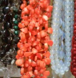 Margele de la un coral. Culoare roz, portocaliu, ceara de culoare