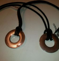 Two steel pendants on black laces
